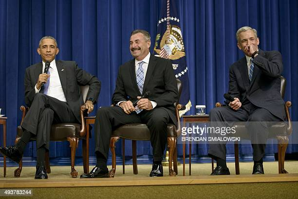 President Barack Obama listens while Charlie Beck , Chief of the Los Angeles Police Department, and John Walsh, United States Attorney for the...