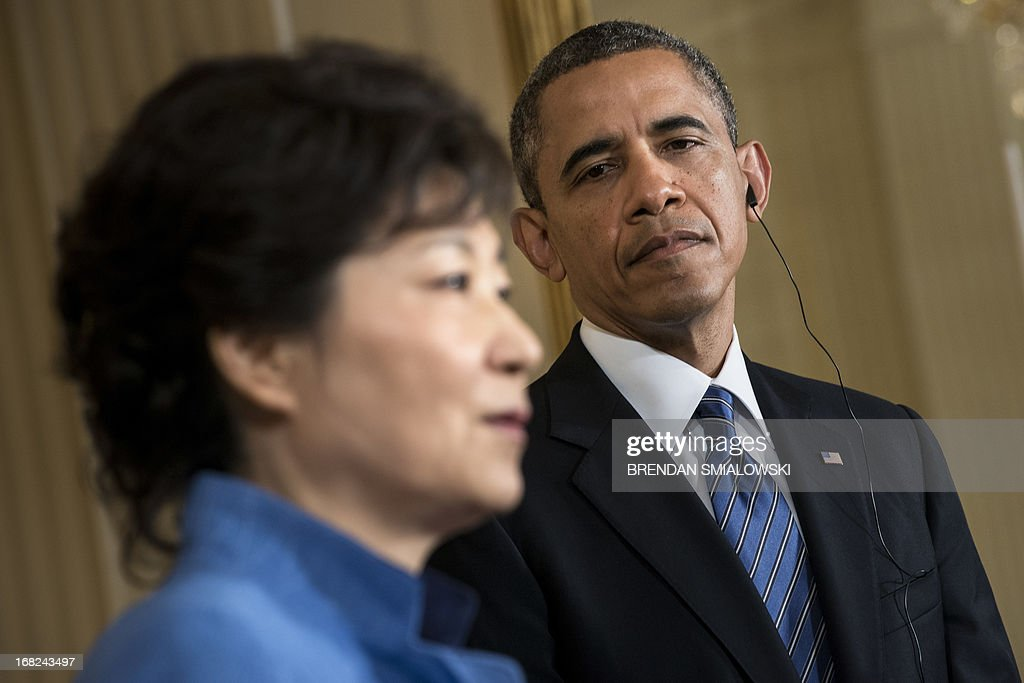 US President Barack Obama listens while President of South Korea Park Geun-hye speaks during a press conference in the East Room of the White House May 7, 2013 in Washington, DC. Obama and Park held the press conference after a meeting in the Oval Office. AFP PHOTO/Brendan SMIALOWSKI