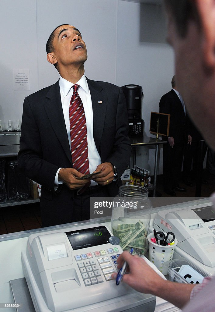 U.S. President Barack Obama looks at a menu as he orders lunch at Ray's Hell Burger May 5, 2009 in Arlington, Virginia. Obama and Biden made an unannouced vist to the Arlington restaurant.