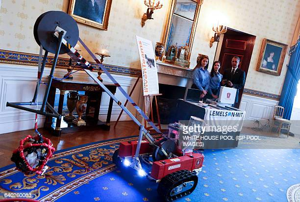 US President Barack Obama looks at the Ice Search and Rescue ROV project of Olivia Van Awsterdam and Katelyn Sweeney from Natick MA during the 2014...