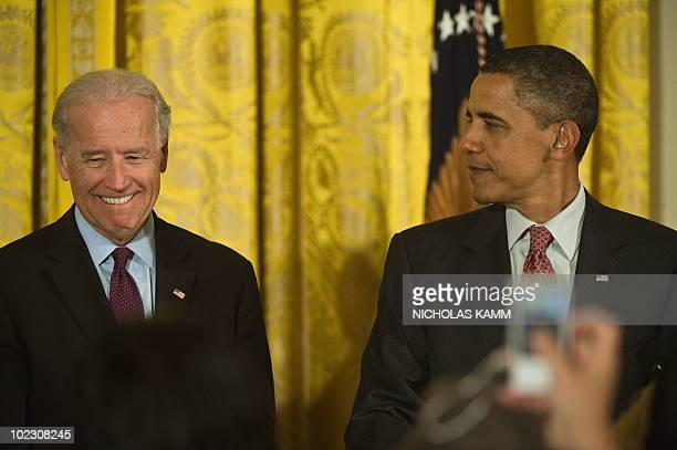 US President Barack Obama looks at Vice President Joe Biden as he introduces him while speaking at a Lesbian Gay Bisexual and Transgender Pride Month...