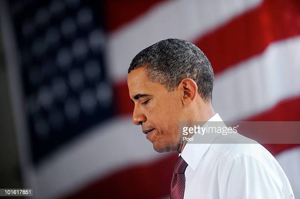 US President Barack Obama looks down as he makes a statement after touring the commercial truck dealership and truck parts supplier K Neal...