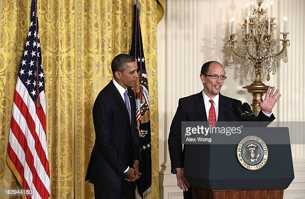 S President Barack Obama looks on as Assistant Attorney General of Justice Department's civil rights division Thomas Perez speaks during a personnel...