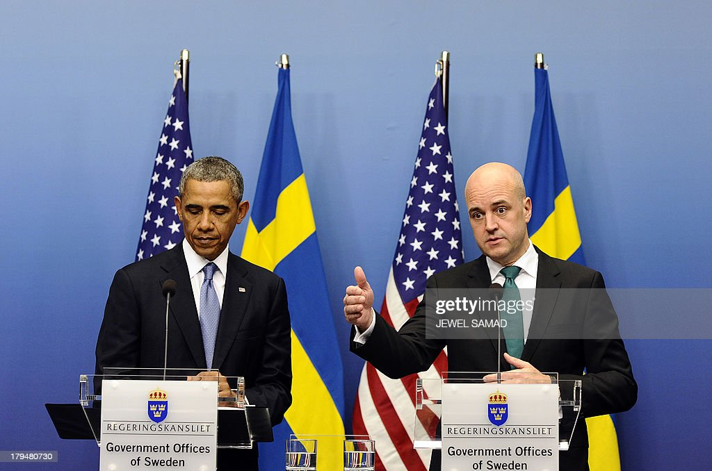 US President Barack Obama (L) looks on as Swedish Prime Minister Fredrik Reinfeldt answers a question during a joint press conference after their bilateral meeting at the Rosenbad Building in Stockholm on September 4, 2013. Obama met with Fredrik Reinfeldt upon arrival in Sweden on a two-day official trip before leaving for Russia, where he will attend G20 summit. Russia on Thursday hosts the G20 summit hoping to push forward an agenda to stimulate growth but with world leaders distracted by divisions on the prospect of US-led military action in Syria.
