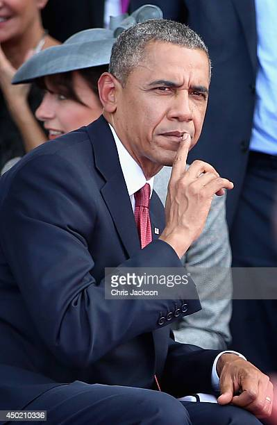 President Barack Obama looks on during a Ceremony to Commemorate D-Day 70 on Sword Beach on June 6, 2014 in Ouistreham, France. Friday 6th June is...