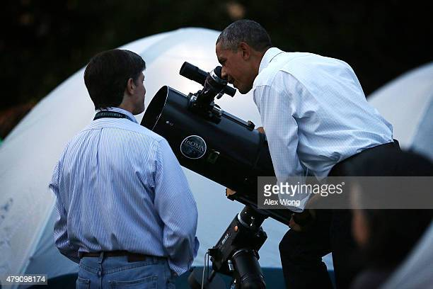 S President Barack Obama looks through a telescope during the firstever White House Campout June 30 2015 at South Lawn of the White House in...