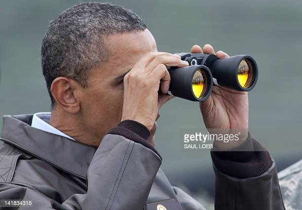 US President Barack Obama looks through binoculars towards North Korea from Observation Post Ouellette during a visit to the Joint Security Area of...