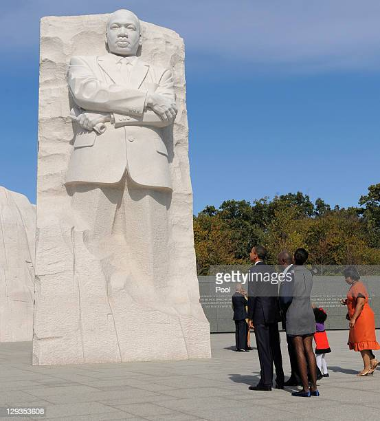 US President Barack Obama looks up along with family members as they arrive for the dedication of the Martin Luther King Jr Memorial on the National...