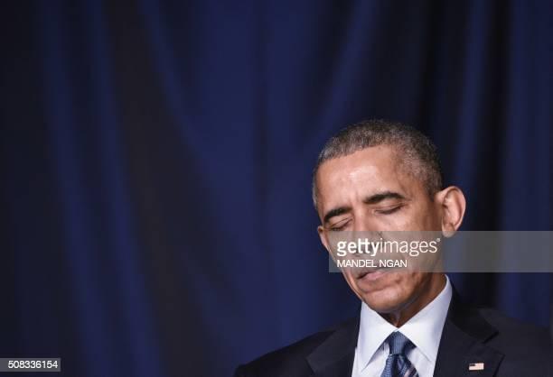 President Barack Obama lowers his head in prayer during the National Prayer Breakfast on February 42016 in Washington DC President Barack Obama...
