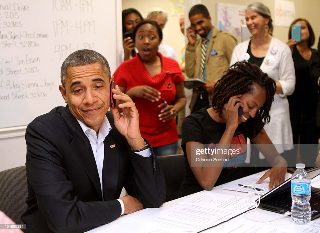 President Barack Obama makes a funny face after he is connected to a wrong number while calling to thank campaign volunteers at the 'Obama For America' field office in Orlando, Florida, Sunday, October 28, 2012.