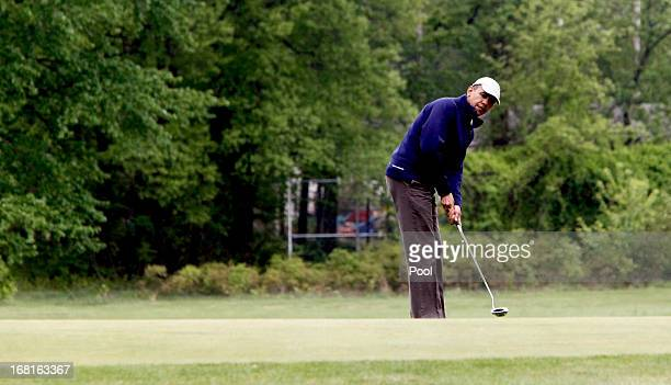 US President Barack Obama makes a shot as he plays golf with some Senators May 6 2013 at Joint Base Andrews Maryland Obama played with US Sen Bob...