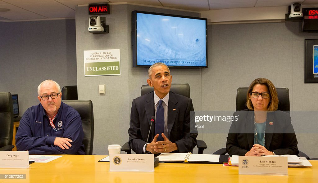 U.S. President Barack Obama makes a statement after receiving a briefing on Hurricane Matthew at the Federal Emergency Management Agency (FEMA) October 5, 2016 in Washington DC. The hurricane has pounded Jamaica and Haiti on its way north toward the U.S. coastline. Also pictured are FEMA Administrator Craig Fugate and Lisa Monaco, Assistant to the President for Homeland Security and Counterterrorism.