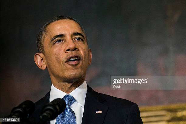 US President Barack Obama makes a statement announcing an interim agreement on Iranian nuclear power in the State Dining Room at the White House on...