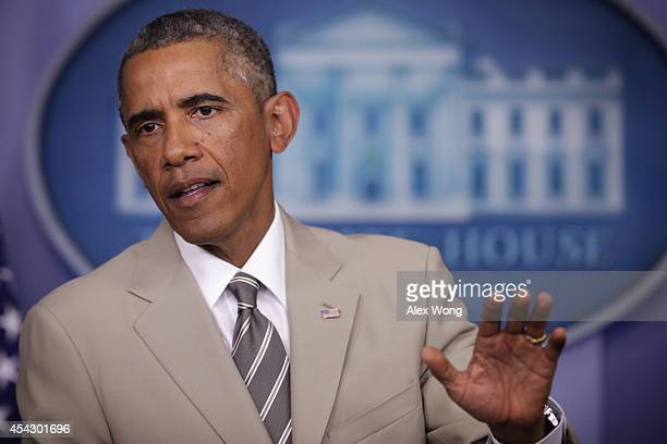 President Barack Obama makes a statement at the James Brady Press Briefing Room of the White House August 28, 2014 in Washington, DC. President Obama...