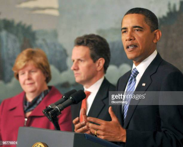 US President Barack Obama makes a statement in the Diplomatic Reception Room of the White House as Timothy Geithner US treasury secretary center and...