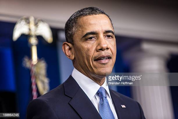 US President Barack Obama makes a statement in the White House Briefing Room following passage by the House of tax legislation on January 1 2013 in...