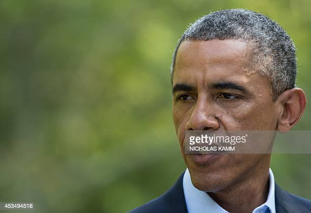 US President Barack Obama makes a statement on the situation in Iraq at Martha's Vineyard Massachusetts on August 11 2014 AFP PHOTO/Nicholas KAMM