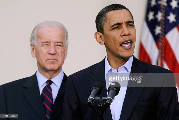 US President Barack Obama makes a statement regarding the Iraqi parliamentary elections as Vice President Joe Biden listens in the Rose Garden of the...