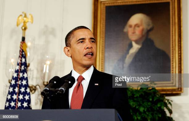US President Barack Obama makes a statement to the press on the economy in the Diplomatic Reception Room at the White House November 12 2009 in...