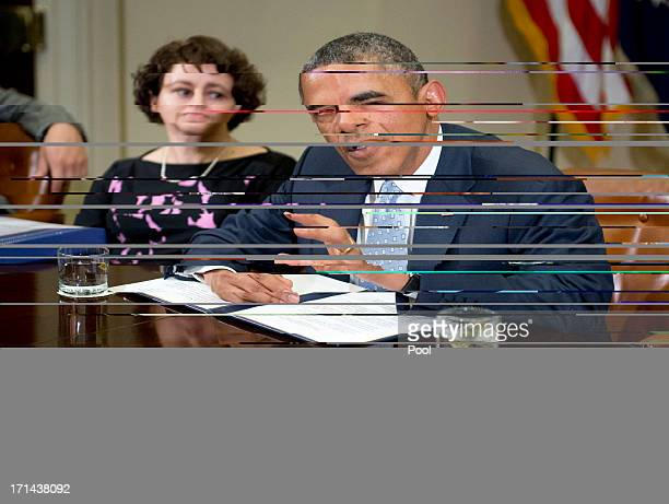 US President Barack Obama makes a statement to the press prior to meeting with CEOs business owners and entrepreneurs in the Roosevelt Room of the...