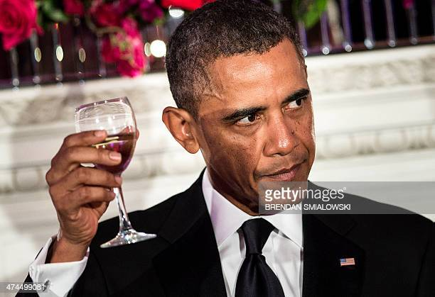 President Barack Obama makes a toast during the 2014 Governors Dinner in the State Dining Room of the White House February 23, 2014 in Washington,...
