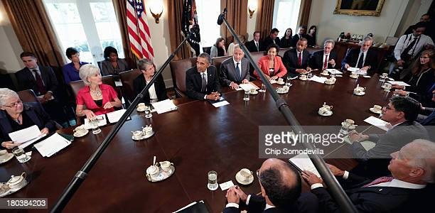S President Barack Obama makes briefs remarks to the news media at the beginning of a cabinet meeting with Environmental Protection Agency...