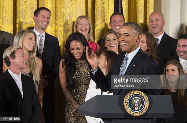 US President Barack Obama makes fun of Sydney Leroux's wave after congratulating her on her recent marriage during an event honoring members of the...