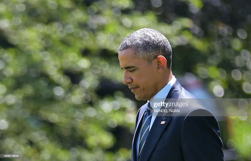 US President Barack Obama makes his way to board Marine One from the South Lawn of the White House on July 14, 2015 in Washington, DC. Obama is heading to Philadelphia to speak at the the NAACP national convention.