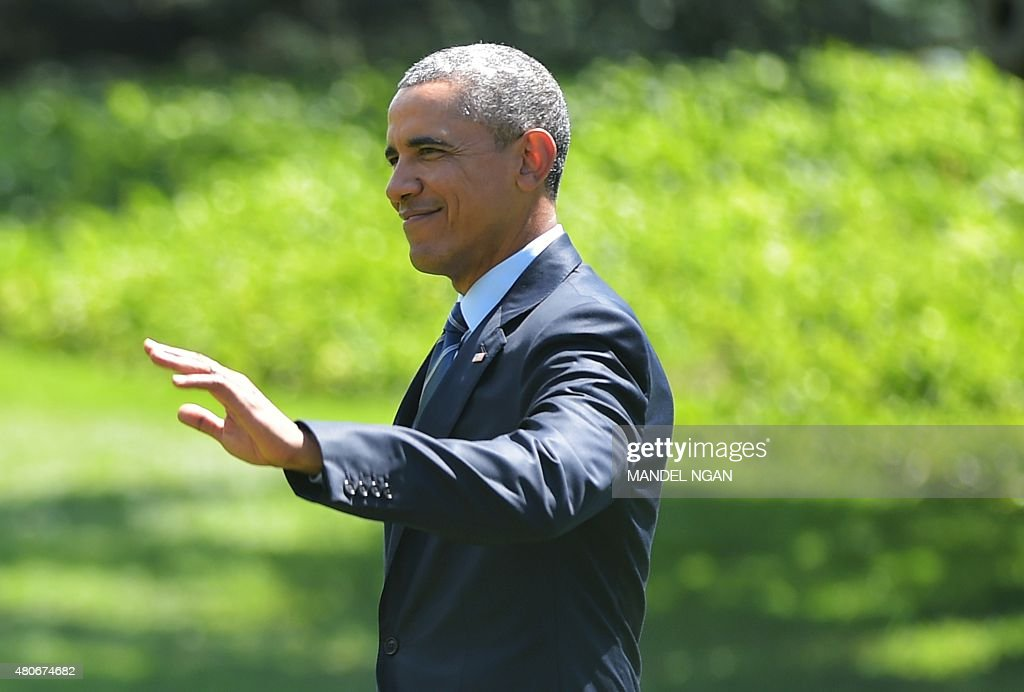 US President Barack Obama makes his way to board Marine One from the South Lawn of the White House on July 14, 2015 in Washington, DC. Obama is heading to Philadelphia, Pennsylvania, to speak at the the NAACP national convention.