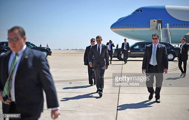 US President Barack Obama makes his way to greet wellwishers September 26 2011 upon arrival at Marine Corps Air Station Miramar in San Diego...