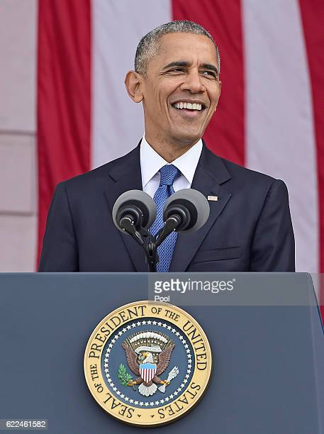 President Barack Obama makes remarks in the Memorial Amphitheater on Veterans Day after laying a wreath at the Tomb of the Unknown Soldier at...