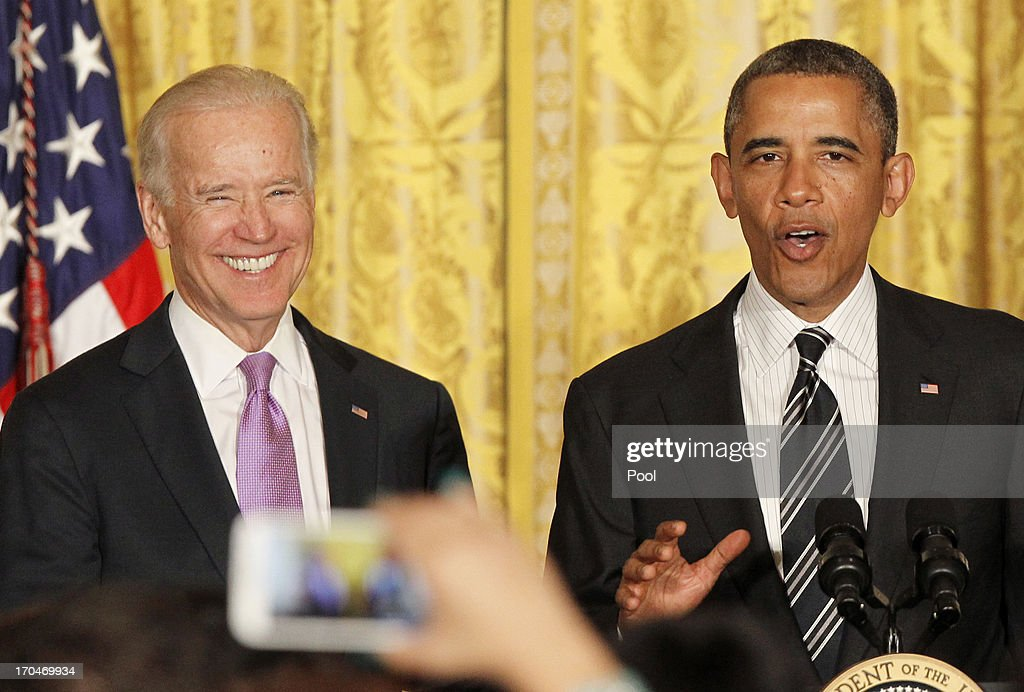U.S. President Barack Obama makes remarks next to Vice President Joe Biden at the LGBT Pride Month celebration on June 13, 2013 in the East Room at the White House in Washington DC.