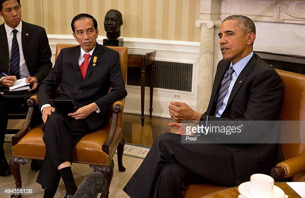 President Barack Obama meets in the with Indonesia President Joko Widodo in the Oval Office of the White House October 26, 2015 in Washington, DC....