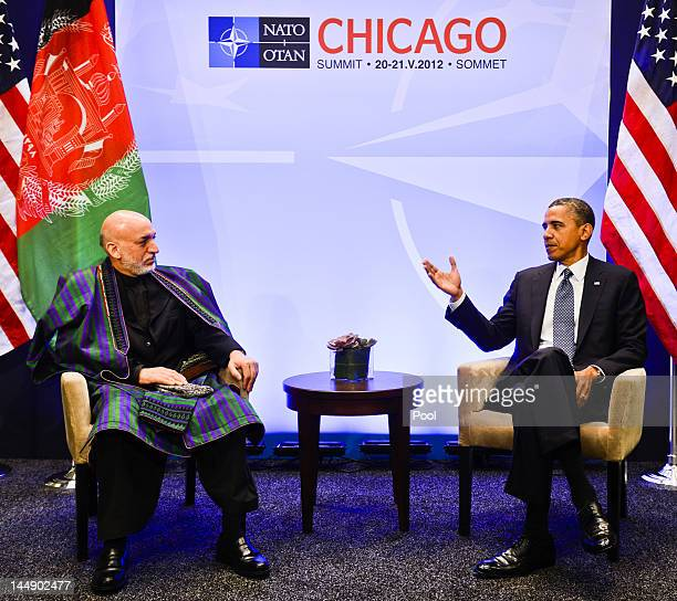 President Barack Obama meets with Afghanistan President Hamid Karzai at the NATO summit at McCormick Place on May 20, 2012 in Chicago, Illinois. As...