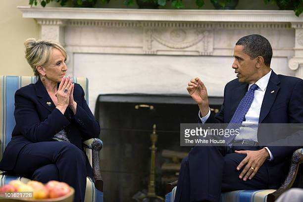 S President Barack Obama meets with Arizona Gov Jan Brewer in the Oval Office of the White House June 3 2010 in Washington DC The two leaders were...