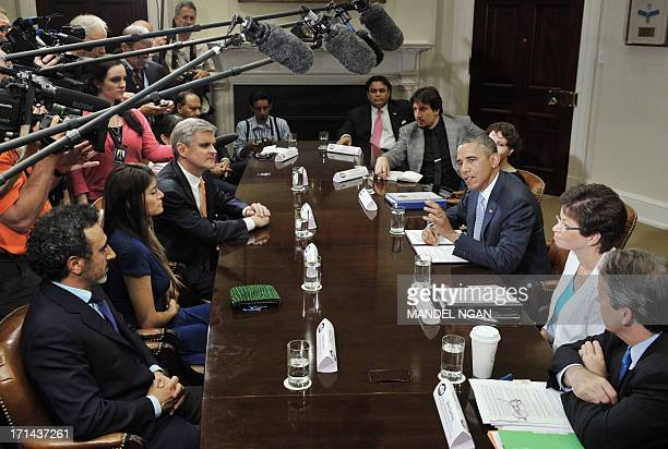 US President Barack Obama meets with business leaders on immigration reform on June 24 2013 in the Roosevelt Room of the White House in Washington DC...