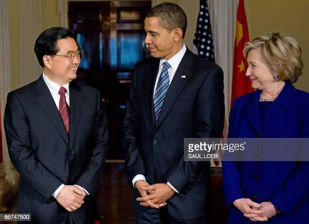 President Barack Obama meets with Chinese President Hu Jintao and and US Secretary of State Hillary Clinton during meetings at the Winfield House,...