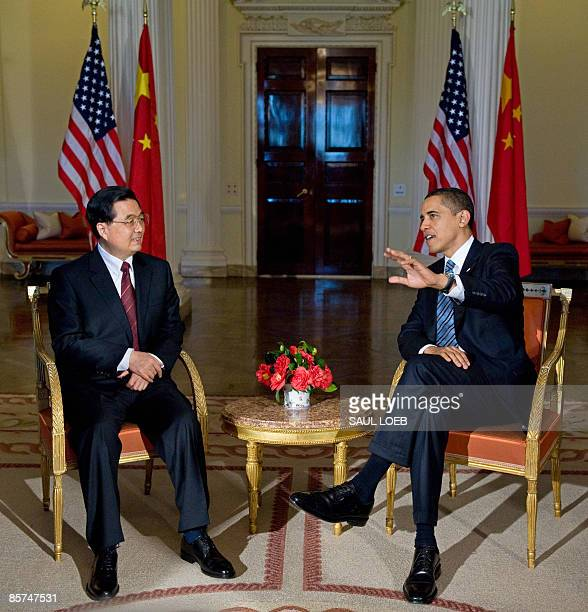 President Barack Obama meets with Chinese President Hu Jintao during meetings at the Winfield House, the US Ambassador's residence in London,...