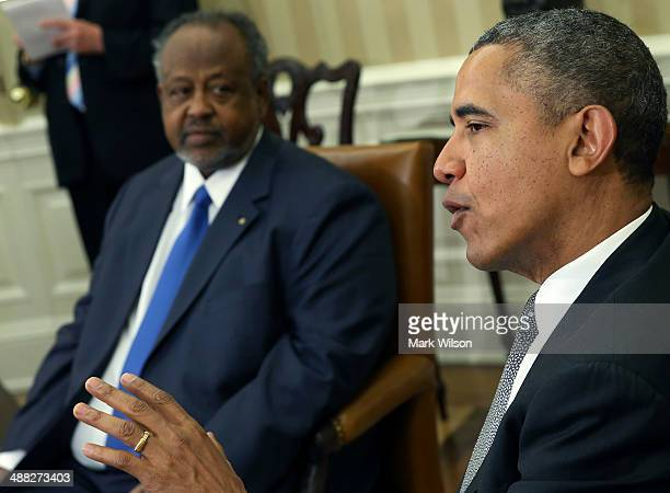S President Barack Obama meets with Djibouti President Ismail Omar Guelleh in the Oval Office at the White House May 5 2014 in Washington DC The two...