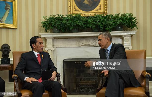 US President Barack Obama meets with his Indonesian counterpart Joko Widodo in the Oval Office at the White House in Washington DC on October 26 2015...