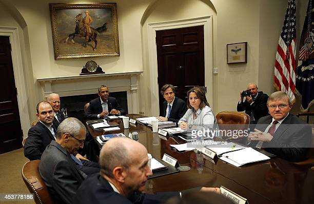 S President Barack Obama meets with members of the National Security Council for an update on Iraq in the Roosevelt Room of the White House August 18...