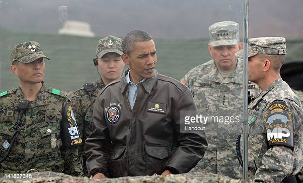 S President Barack Obama meets with military personnel at the Observation Post Ouellette in the Demilitarized Zone which separates the two Koreas in...