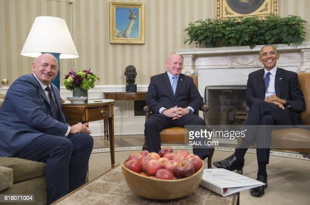 President Barack Obama meets with NASA astronaut Scott Kelly and his twin brother, retired NASA Astronaut Mark Kelly, in the Oval Office of the White...