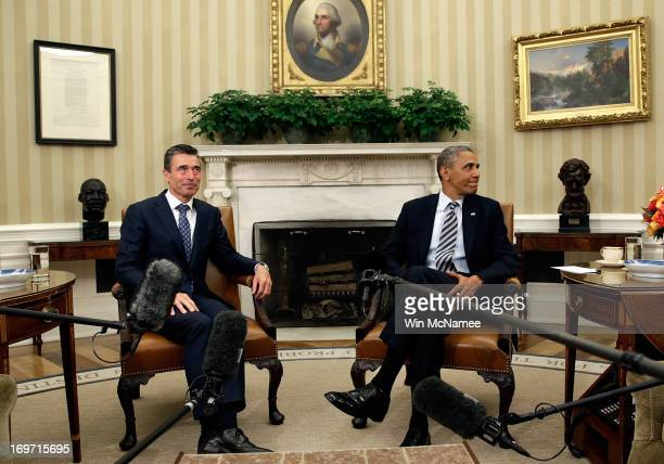 S President Barack Obama meets with NATO Secretary General Anders Fogh Rasmussen in the Oval Office of the White House May 31 2013 in Washington DC...