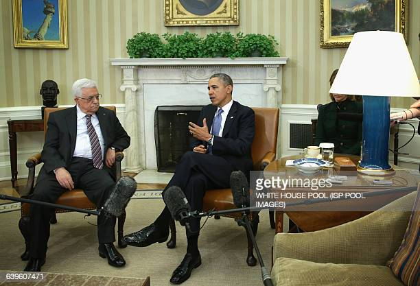 US President Barack Obama meets with Palestinian President Mahmoud Abbas in the Oval Office of the White House March 17 2014 in Washington DC...