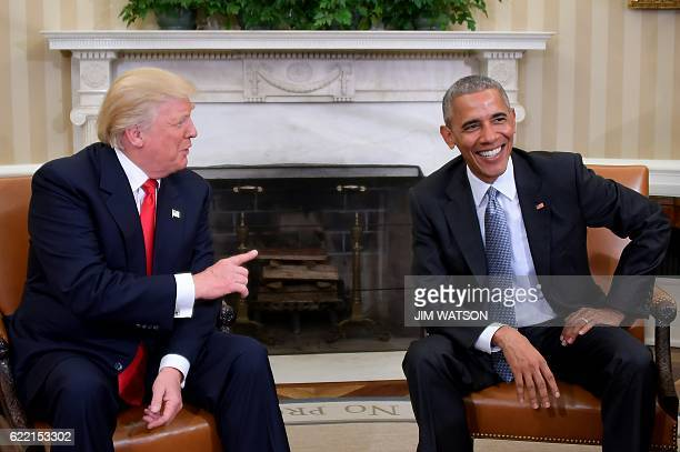 President Barack Obama meets with Presidentelect Donald Trump in the Oval Office at the White House on November 10 2016 in Washington DC / AFP / JIM...