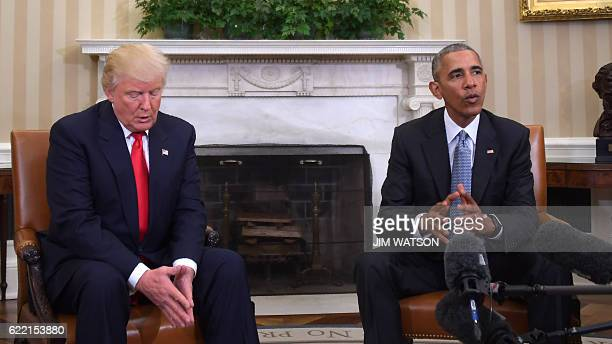 US President Barack Obama meets with Presidentelect Donald Trump in the Oval Office at the White House on November 10 2016 in Washington DC / AFP /...