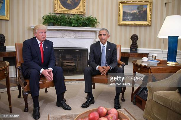 US President Barack Obama meets with Presidentelect Donald Trump to update him on transition planning in the Oval Office at the White House on...