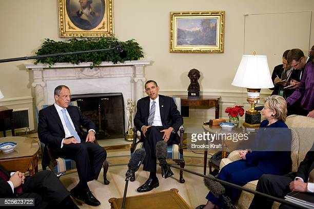 President Barack Obama meets with Russian Foreign Minister Sergey Lavrov in the Oval Office of the White House in Washington On the right is...