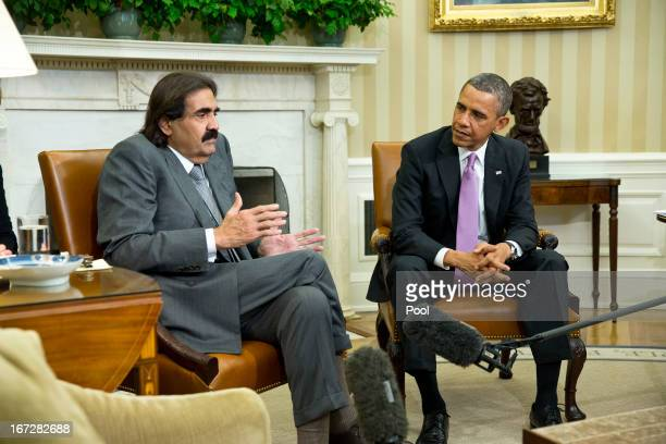 US President Barack Obama meets with the Emir of Qatar Hamad bin Khalifa alThani during a presser in the Oval Office of the White House April 23 2013...